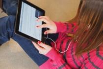 Teenage girl with iPad