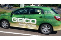 Geico gecko in trademark car